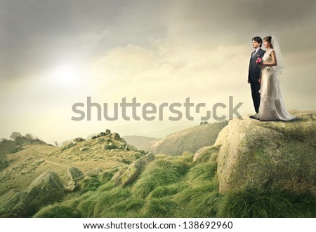 young married couple in the mountains - stock photo