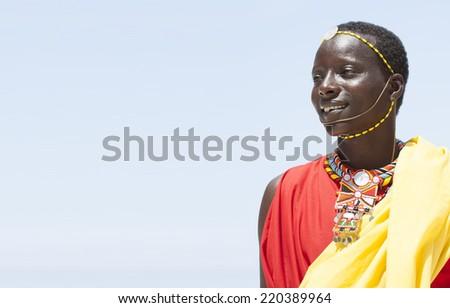 Young massai man posing on bright sunny beach in Kenya. - stock photo
