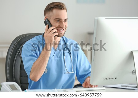 Young Medical Assistant Talking By Telephone Stock Photo (Royalty ...