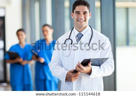 young medical doctor and staff in hospital - stock photo