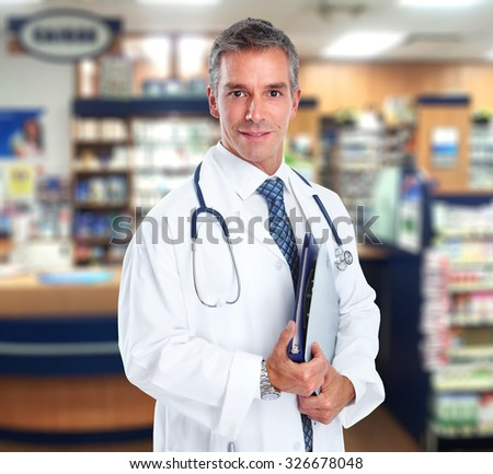 Young medical doctor man over hospital background.
