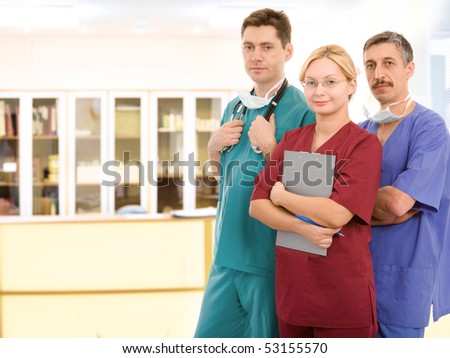 Young medical team in clinic's corridor - stock photo