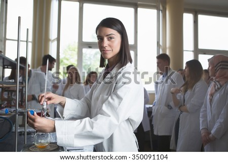 Young medicine developer pharmaceutical researcher.Woman genius chemist.University professor.Intern.Developing new medicine for psychosis and depression in laboratory with herbal extraction.Drugs - stock photo