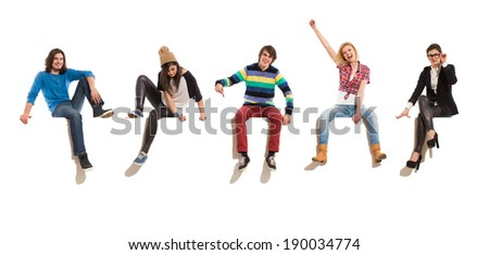 Young men and women sitting on a banner, smiling and gesturing. Full length studio shot isolated on white. - stock photo