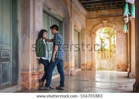 Young men and young women have a conflict in an abandoned building.