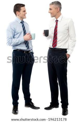 Young men discussing business over a cup of coffee - stock photo