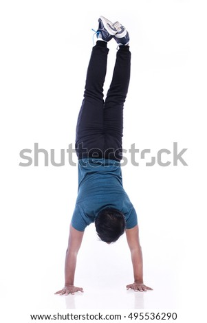 Young men doing staged out hand stand isolated on white background