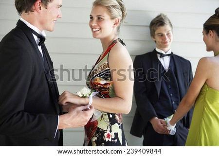 Young Men Giving Corsages to Prom Dates - stock photo