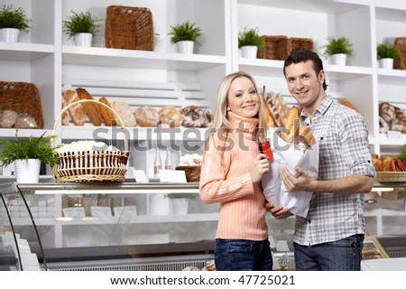 Young men in a baker's shop at a show-window - stock photo