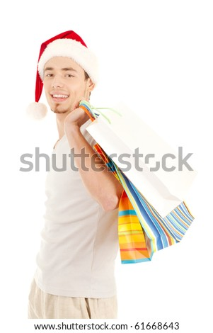 Young men in christmas red hat with paper presents bags isolated on white background - stock photo