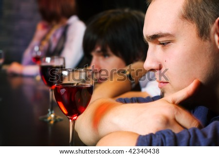 Young men learning on a bar counter. - stock photo