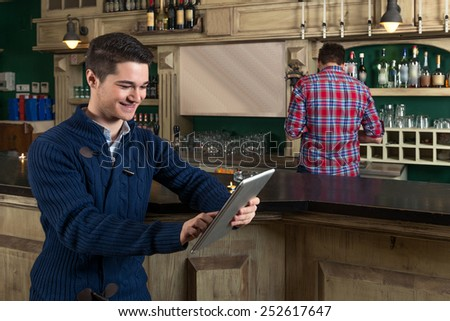 Young men looking at Computer Tablet