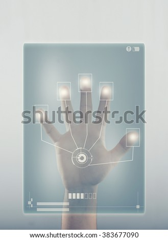 Young men put his hand on a touchscreen and checking data - stock photo