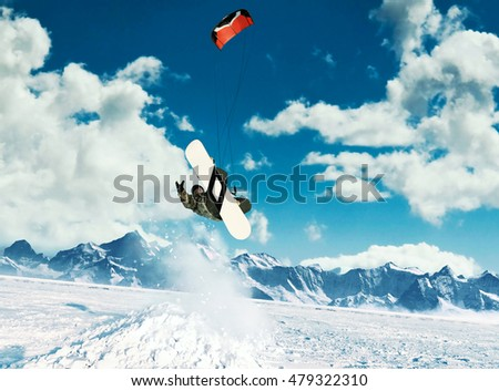 Young men, ride snowboarding on frozen lake in the mountains, in the rays of the rising sun, in winter, on vacation