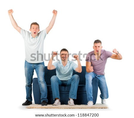 Young men sitting on a sofa cheering, on white background - stock photo