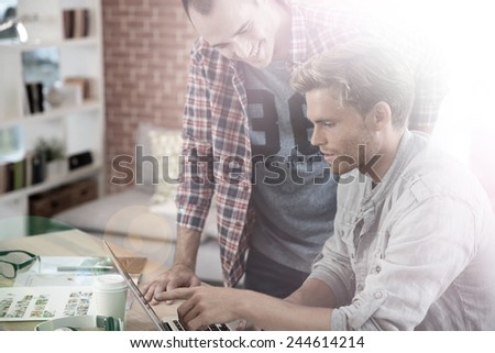 Young men studying in front of laptop - stock photo