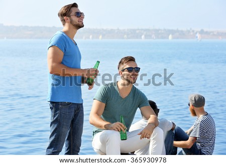 Young men talking on the riverside