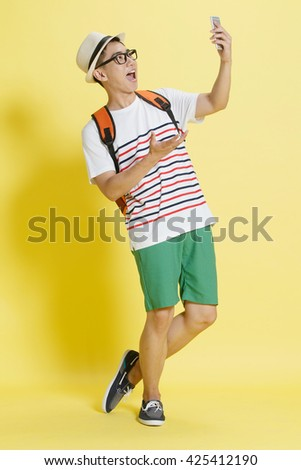Young men use mobile phones to take pictures - stock photo