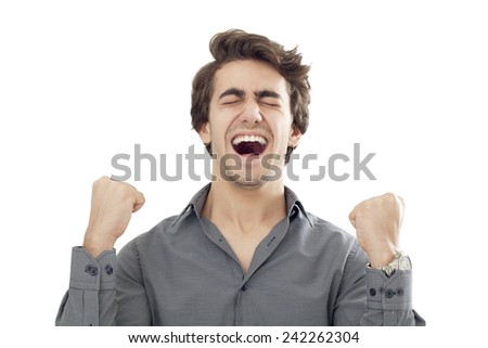 Young men with arms up celebrating his success - stock photo