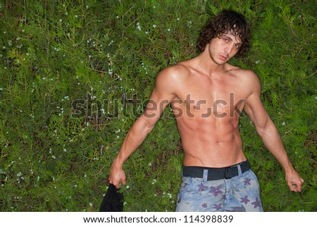 young men with great body on green background