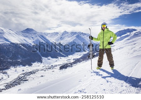 Young men with ski on a mountain winter resort - stock photo