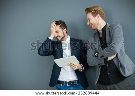 Young men with tablet in the office