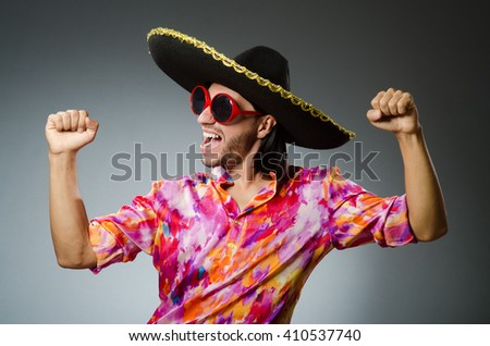 Young mexican man wearing sombrero - stock photo
