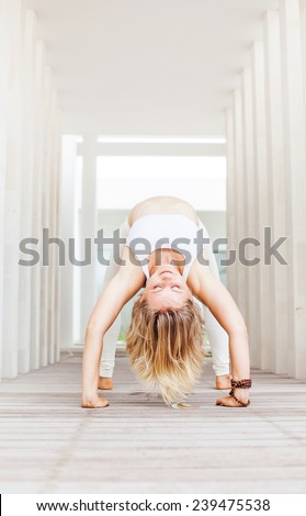 young mighty woman doing yoga in a yoga center - stock photo