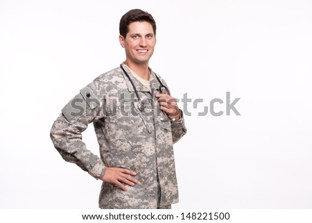 Young military doctor with hand on hips  - stock photo