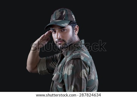 Young military officer saluting - stock photo
