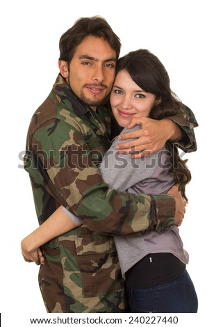 young military soldier returns to meet his wife girlfriend isolated on white - stock photo