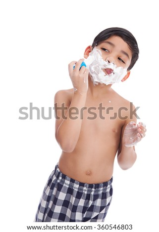 Young, mixed race boy pretending to shave.  Isolated on white.