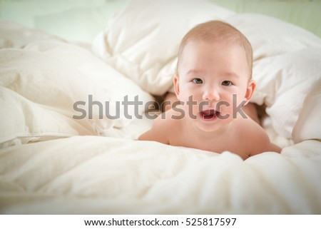 Young Mixed Race Chinese and Caucasian Baby Boy Having Fun in Bed.