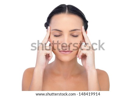 Young model having headache on white background - stock photo