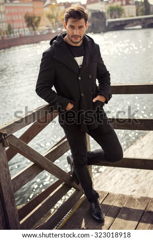 Young model in black coat  - stock photo
