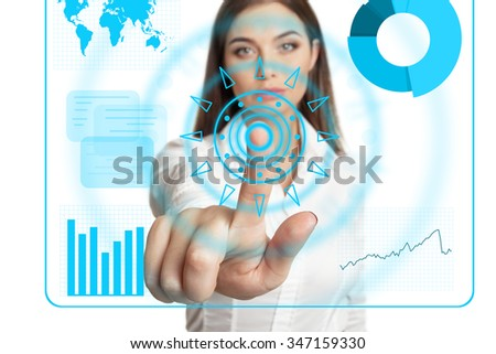 Young model in white blouse using touch screen - stock photo