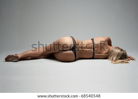 Young model liein on the studio floor in underclothing