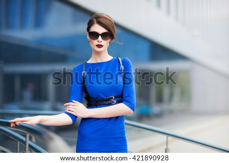 Young model posing in blue dress - stock photo