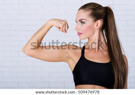 Young model show her biceps