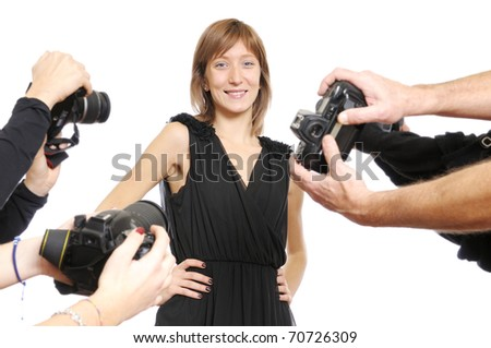 Young model smiling at photographers - stock photo