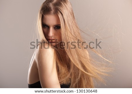 young model with electrified long straight hair - stock photo