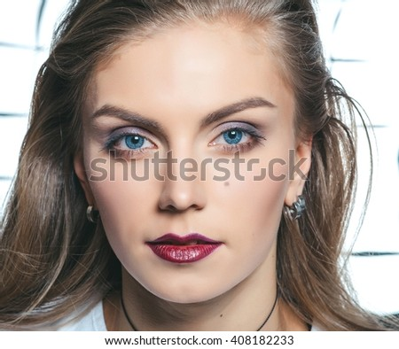 Young model with makeup. Glamour closeup fashion portrait.