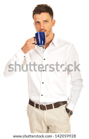 Young modern business man drinking cup of coffee isolated on white background - stock photo