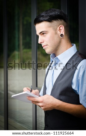 young modern business man make a notice - stock photo