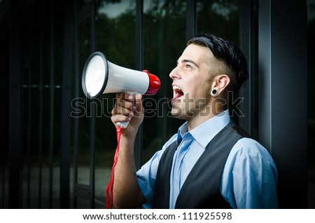 young modern business man with a megaphone