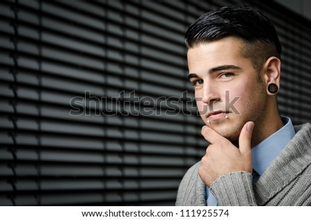 young modern business man with piercings - stock photo