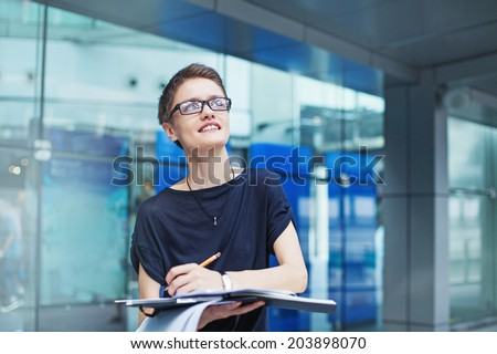Young modern female worker  - stock photo