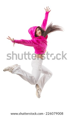 Young modern flexible hip-hop dance girl mid jump. Female in white sweatpants and a pink hoodie and sneakers standing on isolated white background. - stock photo
