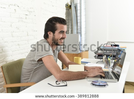 young modern hipster style student or businessman working with laptop computer at home office smiling happy and satisfied in creative freelance business success concept