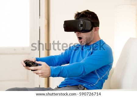 Young Modern Man At Home Living Room Sofa Couch Playing Video Game Excited Using 3d Goggles
